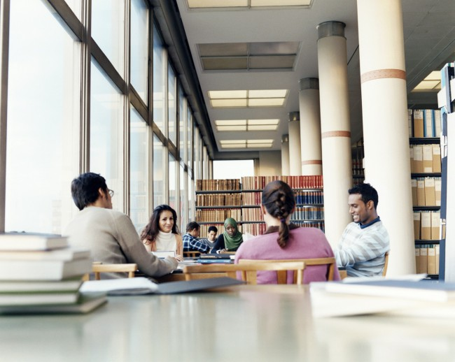 Surface Level Shot of Mature Students Studying at a Table in a University Library